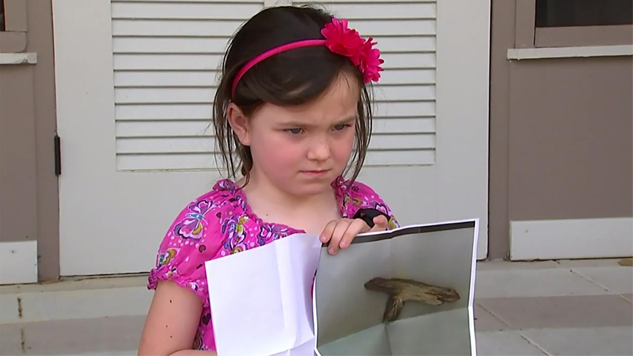 Caitlin Miller, 5, was suspended for this stick that resembles the shape of a gun_241760