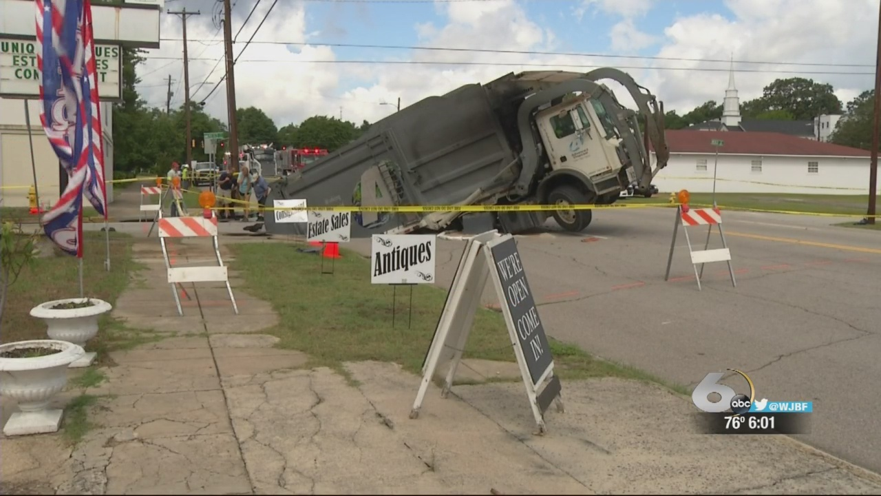 Sink hole swallows garbage truck