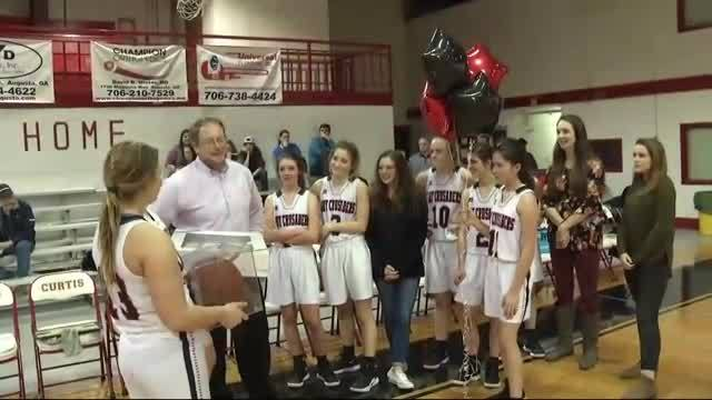 Local coach celebrates milestone