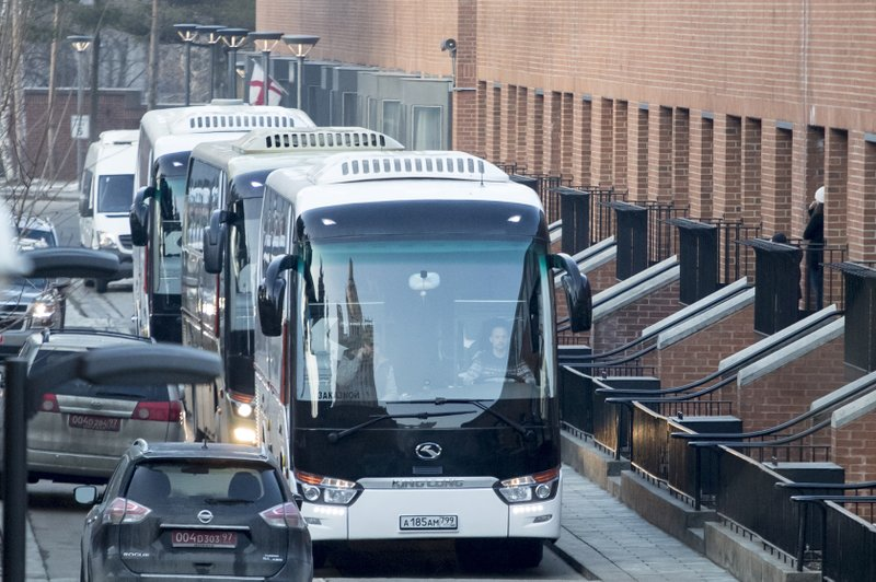 Buses leave U.S. embassy in Russia_1522922227224.jpeg.jpg