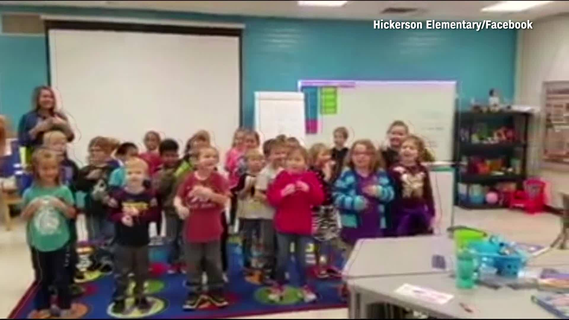 Students surprise deaf custodian, sign Happy Birthday