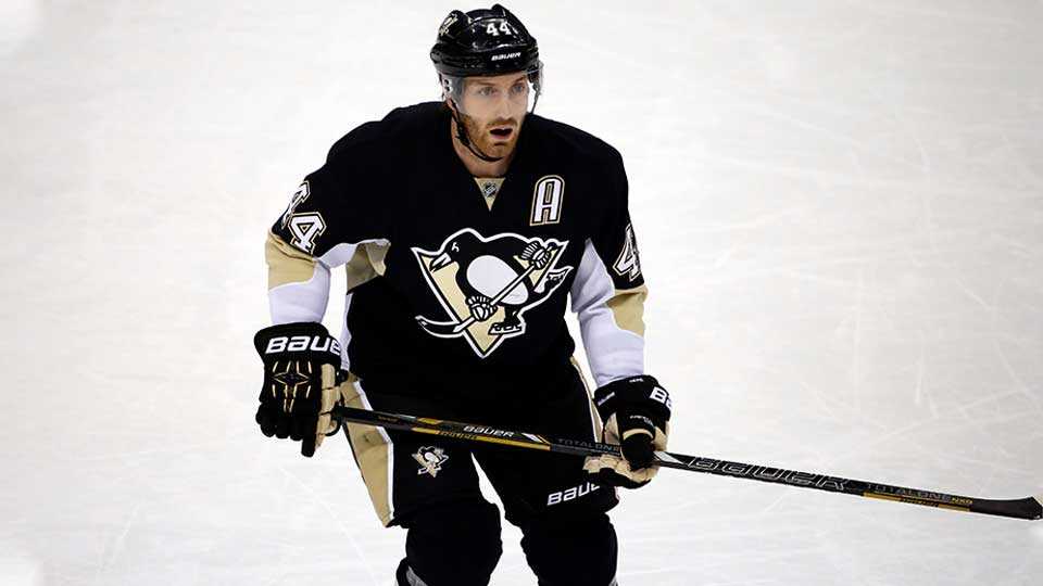 Former Pittsburgh Penguins' Brooks Orpik skating on the ice during a National Hockey League game.