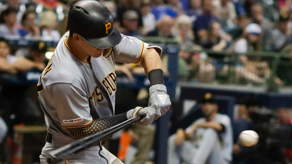 Pittsburgh Pirates' Kevin Newman hits an RBI fielder's choice during the ninth inning of the team's baseball game against the Milwaukee Brewers.