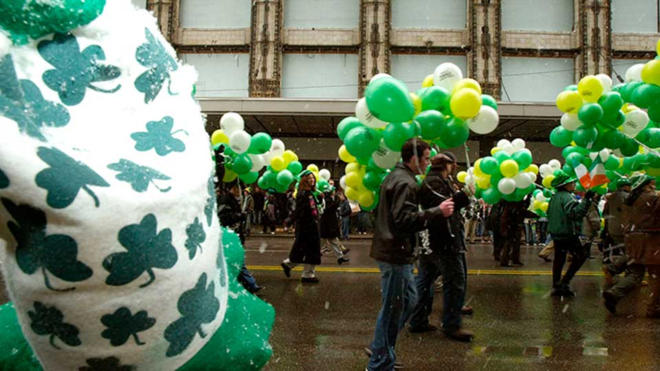 Paraders are framed by a St. Patrick's Day hat during the St. Patrick's Day Parade in Cleveland Wednesday, March 17, 2004.