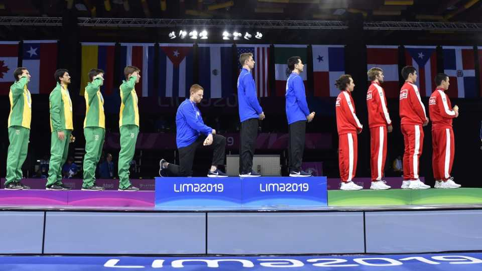 Race Imboden of the United States takes a knee