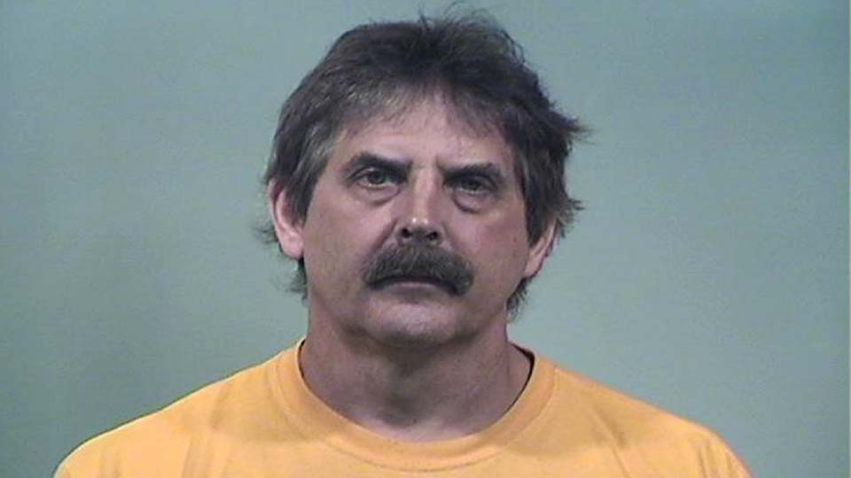 Brian Bickel, charged with discharge of a firearm on prohibited premises in Champion.