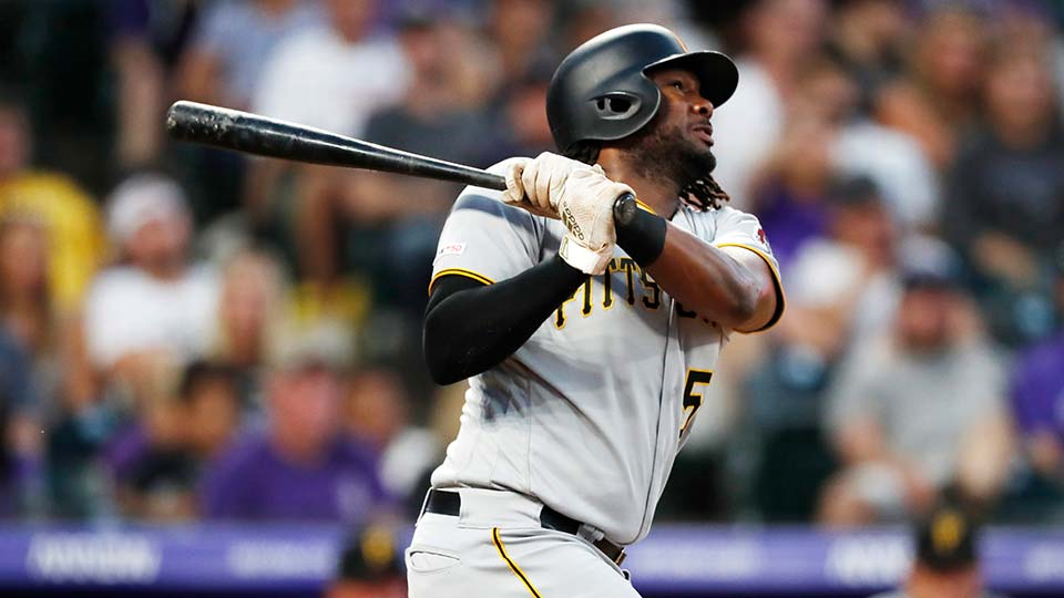Pittsburgh Pirates' Josh Bell follows the flight of his solo home run off Colorado Rockies relief pitcher Wes Parsons.