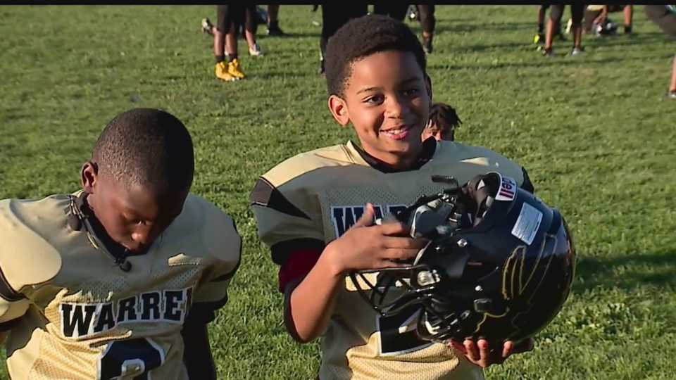 Warren Little Raiders football team gets new helmets