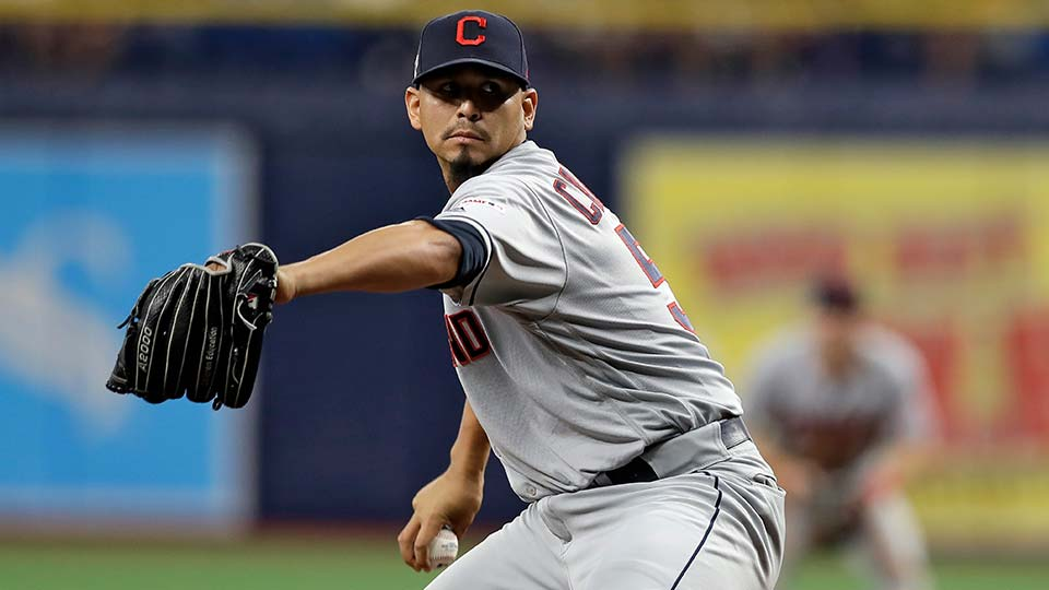 Cleveland Indians pitcher Carlos Carrasco delivers to the Tampa Bay Rays during the seventh inning of a baseball game.