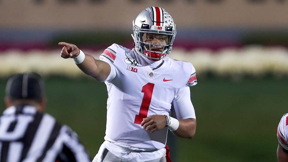 Ohio State quarterback Justin Fields points out the defense during the first half of an NCAA college football game against Northwestern.