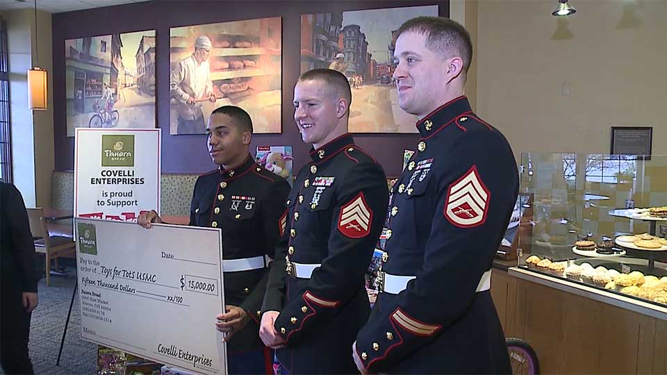 Covelli Enterprises presented $15,000 to the U.S. Marine Corps Toys for Tots.