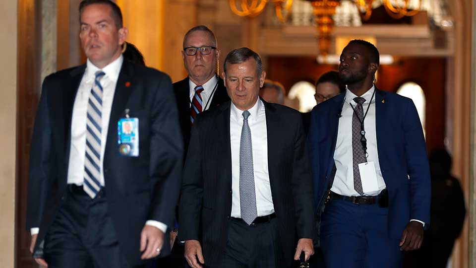 "Supreme Court Chief Justice John Roberts, center, arrives at the Capitol in Washington, Wednesday, Jan. 22, 2020. The U.S. Senate plunges into President Donald Trump's impeachment trial with Republicans abruptly abandoning plans to cram opening arguments into two days but solidly rejecting for now Democratic demands for more witnesses to expose what they deem Trump's ""trifecta"" of offenses. Trump himself claims he wants top aides to testify, but qualified that by suggesting there were ""national security"" concerns to allowing their testimony."