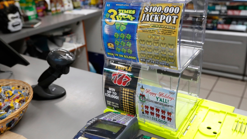 A scratch-off lottery ticket dispenser is displayed at this RaceWay store in Jackson, Miss., Tuesday, Nov. 19, 2019.