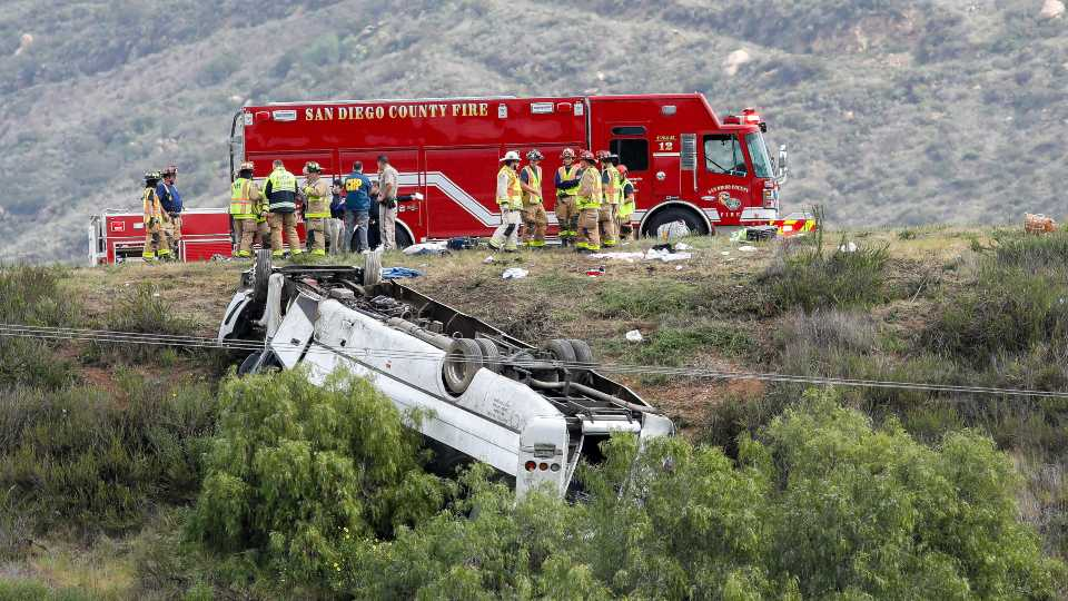 A bus rolled down an embankment off Interstate 15 in North San Diego County Saturday, Feb. 22, 2020, killing several people and injuring others. Emergency crews rescued several people trapped in the wreckage after the bus crashed around 10:20 a.m. on State Route 76, about 45 miles (72 kilometers) north of San Diego, the North County Fire Protection District said.