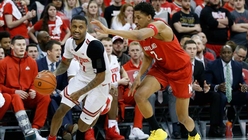 Ohio State's Luther Muhammad, left, brings the ball upcourt past Maryland's Aaron Wiggins during the second half of an NCAA college basketball game Sunday, Feb. 23, 2020, in Columbus, Ohio.