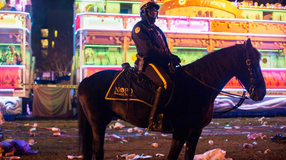 A police officer works the scene where a man was reportedly hit and killed by a float of the Krewe of Endymion parade in the runup to Mardi Gras in New Orleans, Saturday, Feb. 22, 2020. A person was struck by a float and fatally injured Saturday evening during one of the iconic parades of the Mardi Gras season in New Orleans, authorities said. It was the second death in days to mar this year's Carnival festivities.