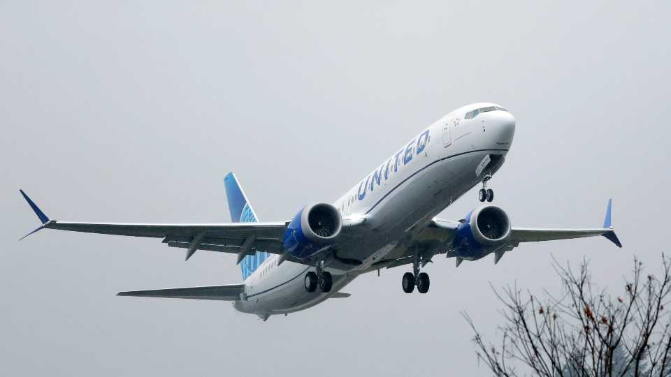 In this Dec. 11, 2019, file photo, an United Airlines Boeing 737 Max airplane takes off in the rain at Renton Municipal Airport in Renton, Wash. United Airlines said Friday, Feb. 14, 2020, that it is removing the grounded Boeing 737 Max from its schedule until early September, forcing it to cancel thousands more flights.