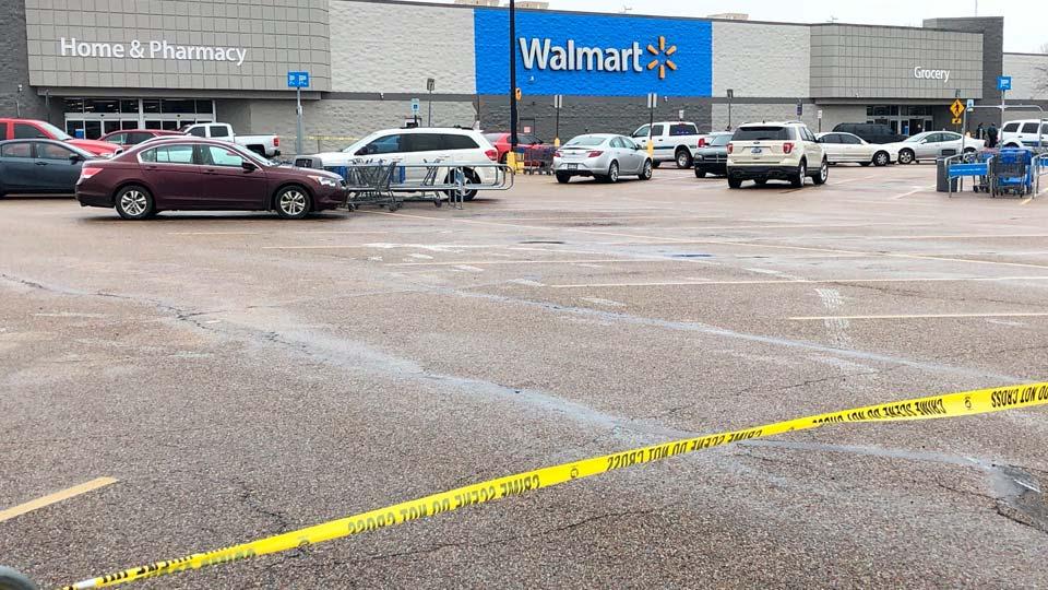 Police tape blocks off a Walmart store parking lot in Forrest City, Arkansas