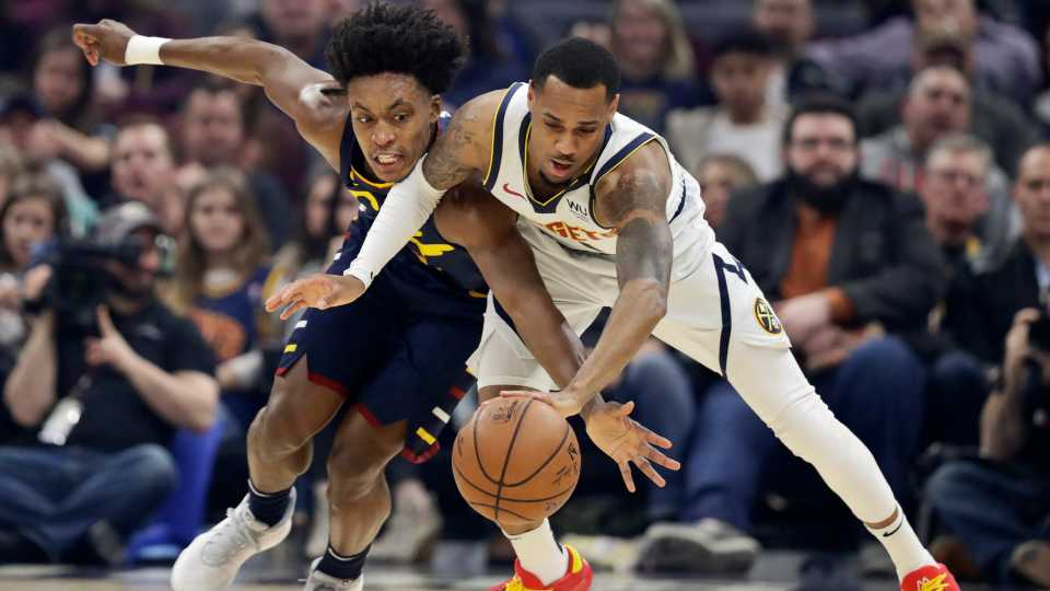 Cleveland Cavaliers' Collin Sexton, left, and Denver Nuggets' Monte Morris battle for a loose ball in the first half of an NBA basketball game, Saturday, March 7, 2020, in Cleveland.
