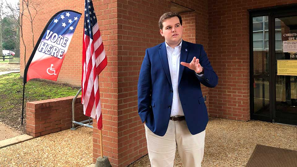 University of Memphis student Landon Shelby speaks with a reporter outside an off-campus voting location on Tuesday, Feb. 25, 2020, in Memphis, Tenn. Shelby, a Republican, said he would like to see the university have a polling location on campus to help students cast ballots more easily.