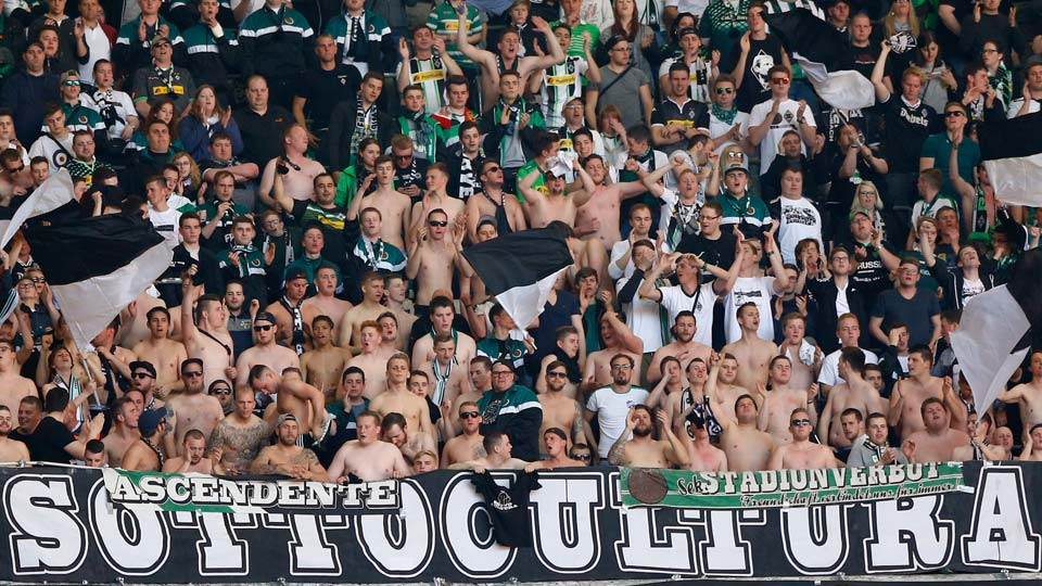 Moenchengladbach supporter cheer their team during the German Bundesliga soccer match