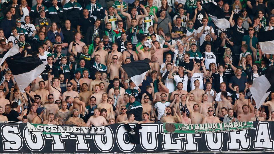 Moenchengladbach supporter cheer their team during the German Bundesliga soccer match