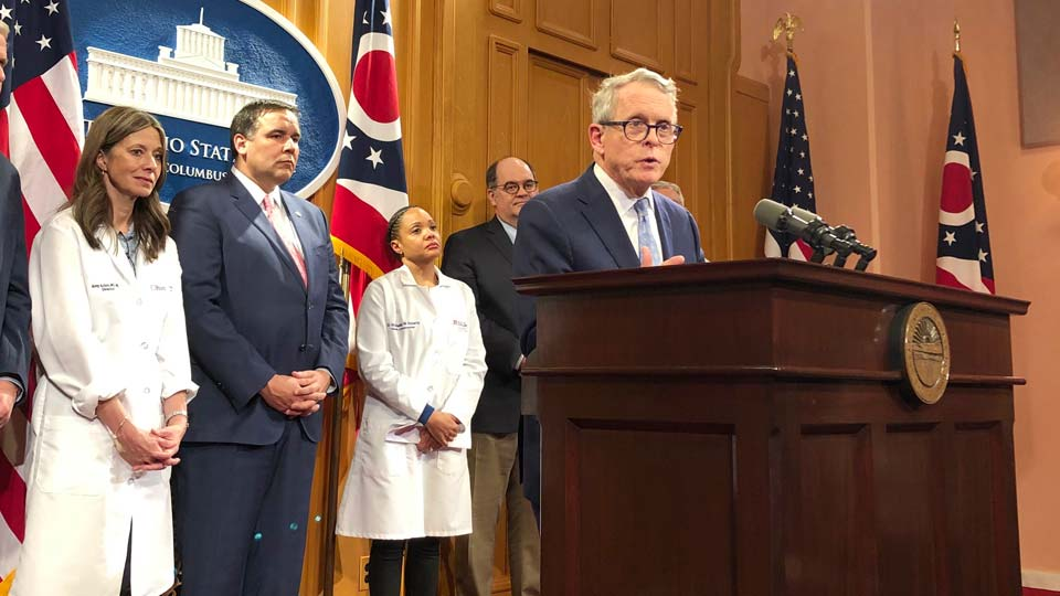 Ohio Gov. Mike DeWine speaks at a news conference at the statehouse in Columbus, Ohio