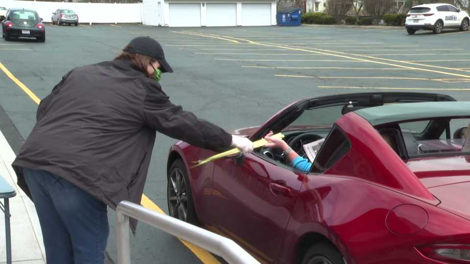 Churches adapt with drive thru Palm Sunday.