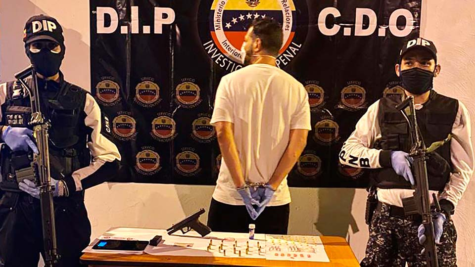 Venezuelan police officers present a suspect arrested at a multiday party in Caracas
