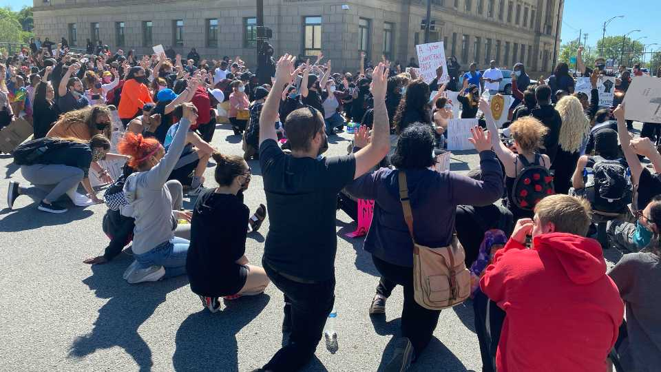 Crowd kneeling in middle of market street, Youngstown protests
