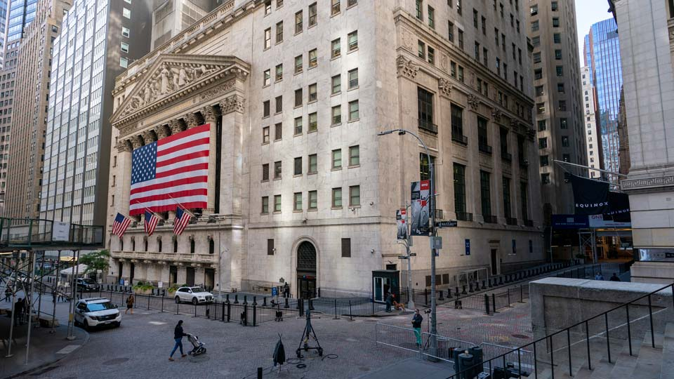 A giant American Flag hangs on the New York Stock Exchange, Monday, Sept. 21, 2020