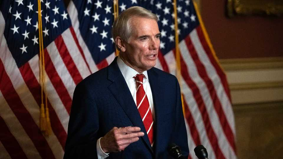 """FILE - This Monday, Oct. 26, 2020, file photo shows Sen. Rob Portman, R-Ohio, speaking during a news conference in Washington. Portman is participating in a COVID-19 vaccine study, hoping to encourage others to volunteer to take part in testing. Portman said in an interview that as much as he supports such precautions as masking and social distancing, vaccine development, distribution and use are the best hope for reducing the pandemic's toll, and he wanted to what he could to help """"explain the great potential for these vaccines"""" and the need for volunteers for trials."""