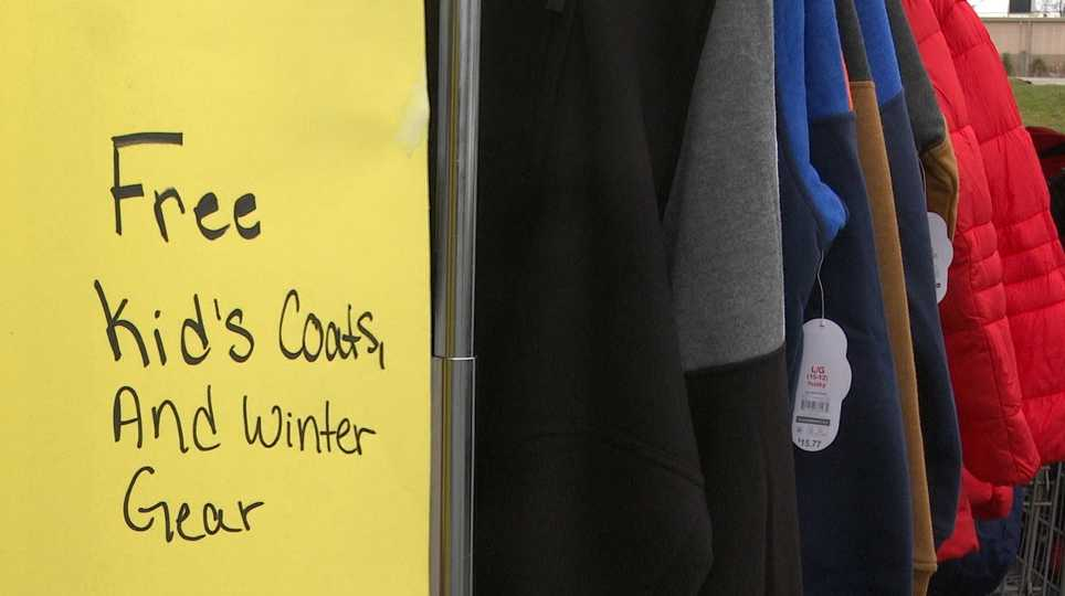 Families could get free coats and winter gear at the American Warehouse Outlet in Boardman Saturday.