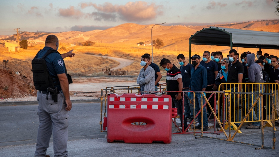 Israel vaccinating West Bank laborers