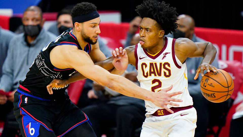 Cleveland Cavaliers' Collin Sexton, right, tries to get past Philadelphia 76ers' Ben Simmons during the second half of an NBA basketball game, Saturday, Feb. 27, 2021, in Philadelphia.
