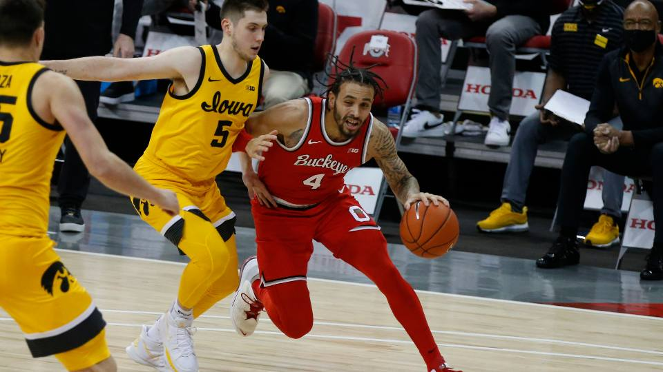 Ohio State's Duane Washington, right, drives the baseline against Iowa's C.J. Fredrick during the first half of an NCAA college basketball game Sunday, Feb. 28, 2021, in Columbus, Ohio.