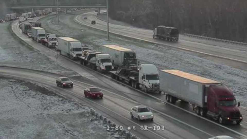 Cars and semi-trucks are also stopped on I-80 near state Route 193.