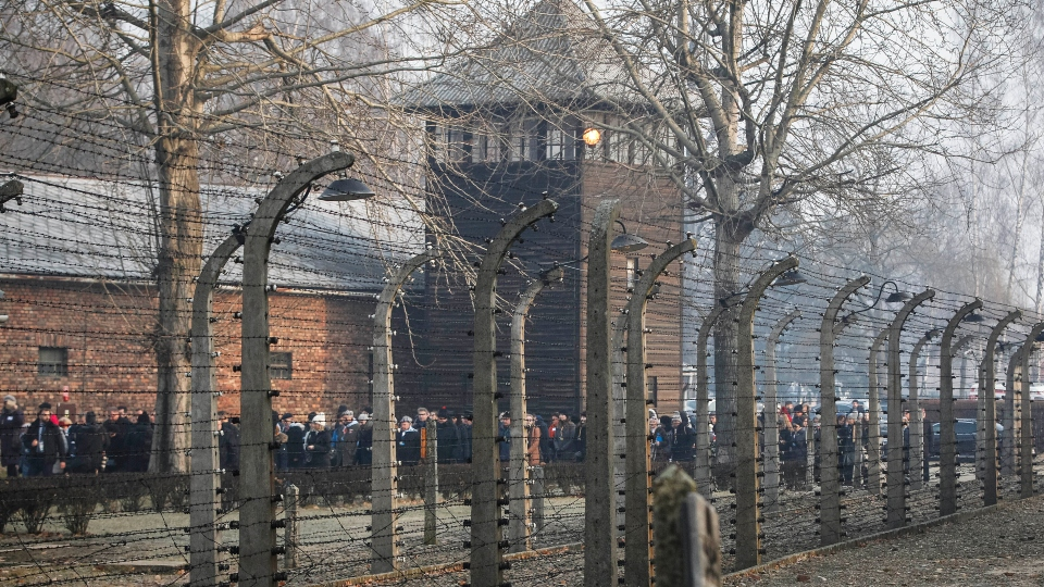 n this file photo taken Jan. 27, 2020, people are seen arriving at the site of the Auschwitz-Birkenau Nazi German death camp, where more than 1.1 million were murdered, in Oswiecim, Poland, for observances marking 75 years since the camp's liberation by the Soviet army