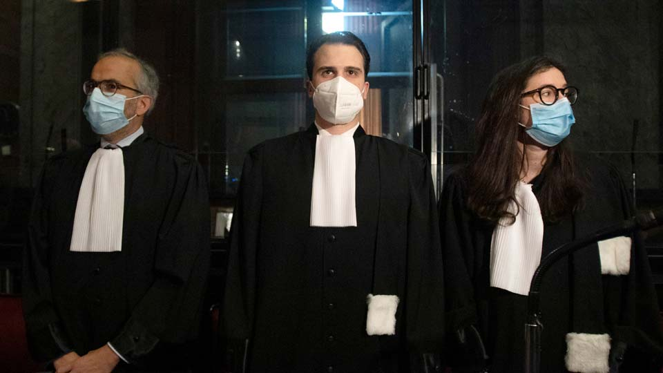 FILE - In this May 26, 2021, file photo, lawyers for AstraZeneca Clemence Van Muylder, right, and Hakim Boularbah, left, wait for the start of a hearing, European Commission vs AstraZeneca, at the main courthouse in Brussels. Coronavirus vaccine-maker AstraZeneca is claiming victory in a court tussle with the European Union over allegations that it was not producing shots fast enough. In a statement Friday, June 18 they said the EU's executive branch, the European Commission, had requested that the drug-maker deliver 120 million vaccine doses in total by the end of June 2021, but that a judge in Brussels ordered delivery of 80.2 million doses by 27 September 2021. (AP Photo/Virginia Mayo, File)