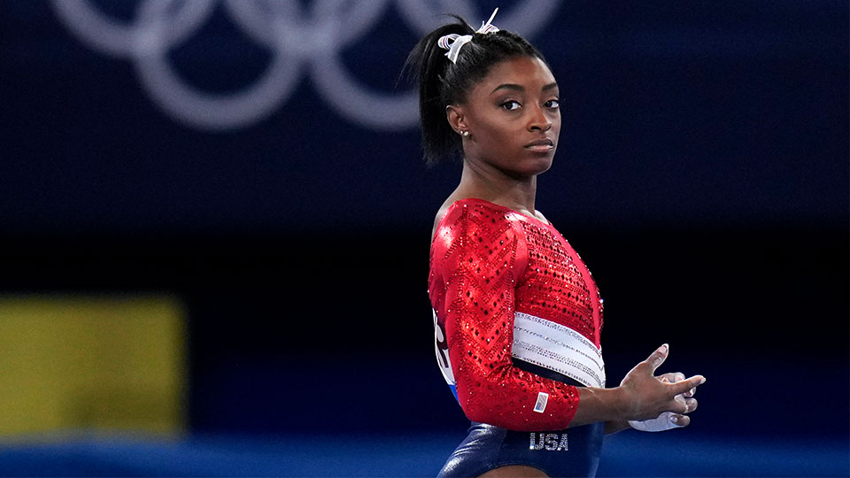 Simone Biles, of the United States, waits to perform on the vault during the artistic gymnastics women's final at the 2020 Summer Olympics, Tuesday, July 27, 2021, in Tokyo