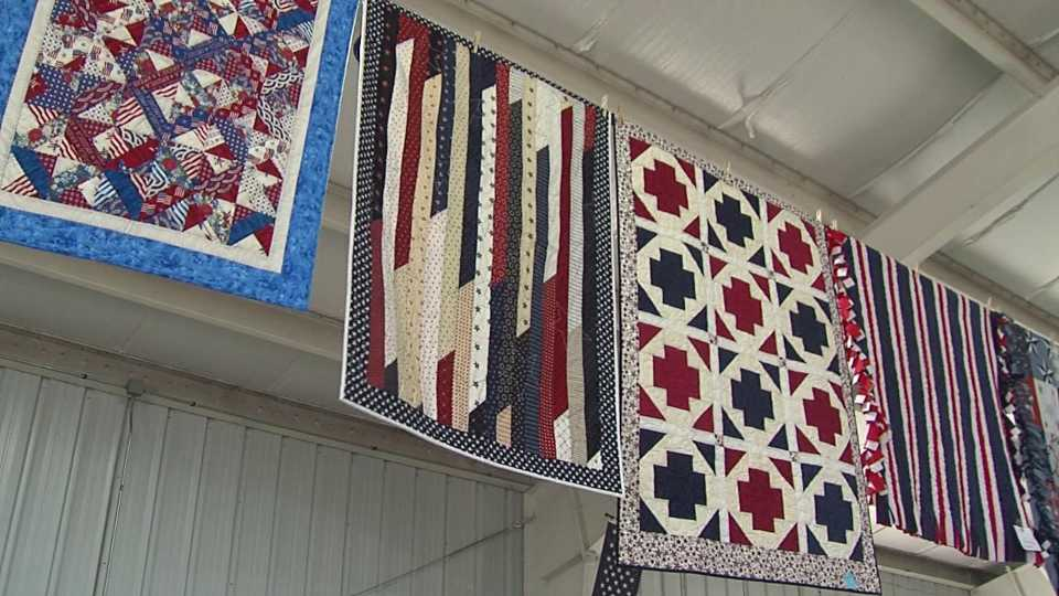 Quilts hanging up at the Columbiana County Fair will be given to veterans.