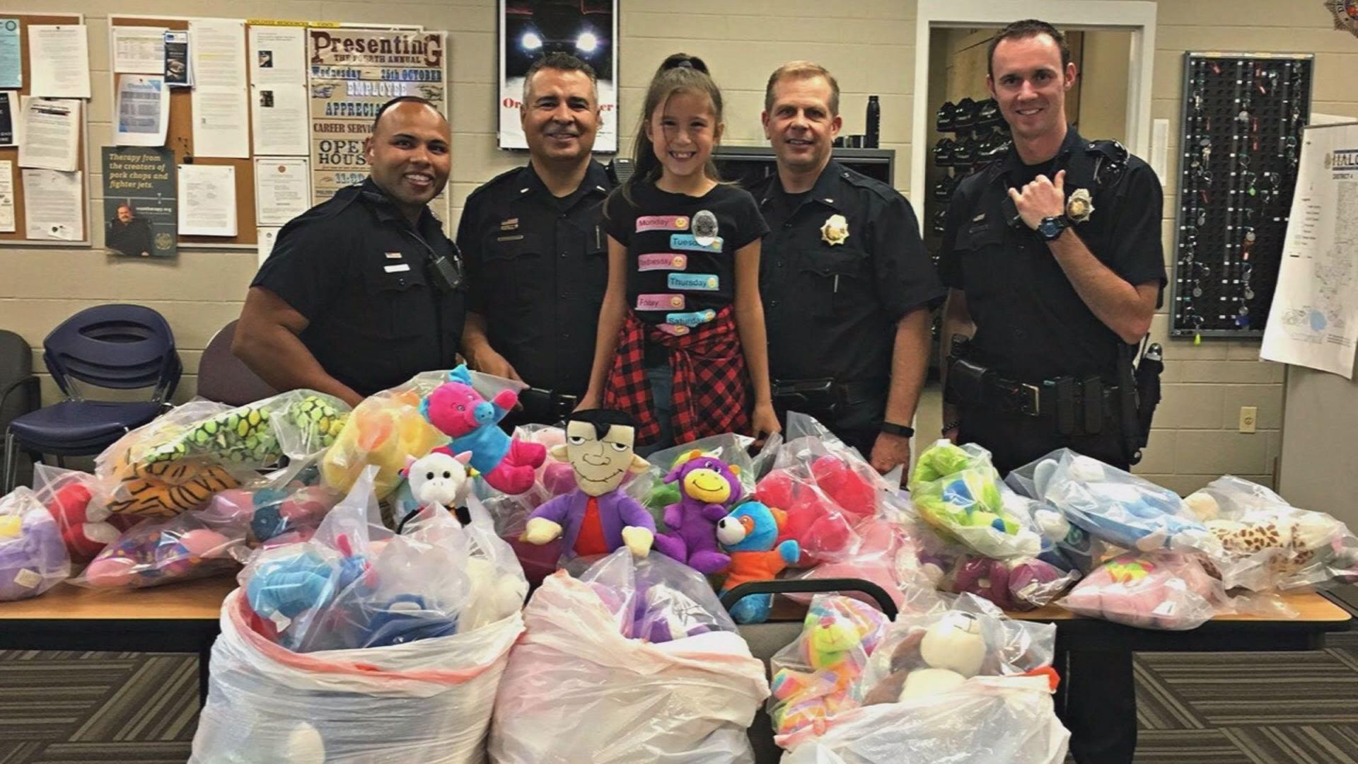 girl donates stuffed animals_431729
