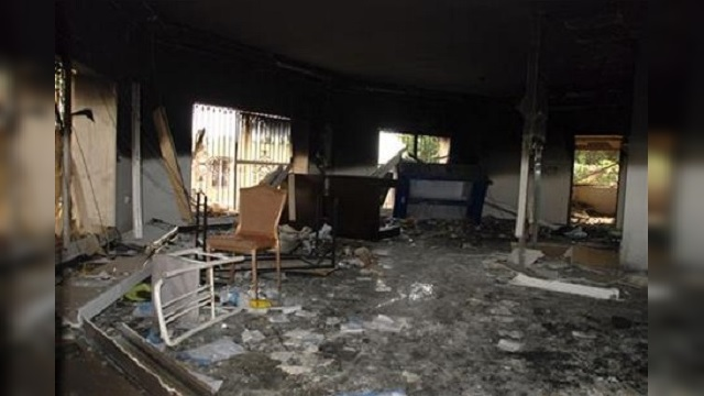 Glass, debris and overturned furniture are strewn inside a room in the gutted U.S. consulate in Benghazi, Libya, after an attack that killed fo_295191