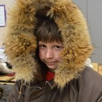 Second grader William Conley tries on musher gear