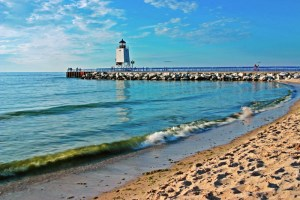 This photo was taken during a calm summer day from Lake Michigan Beach. For such a plain looking lighthouse, it is surprisingly very photogenic, thanks to the sleek profile of the south pier and beautiful background sunsets.