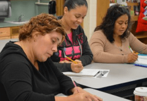 Parents study the usage of 'will go' and 'am going to go' during class
