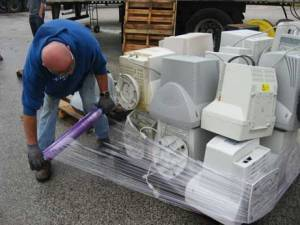 Workers prepare computers to be hauled away during last year's environmental collection event