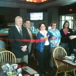 Officials cut the ribbon to open the newly remodeled Swan Lake Resort Restaurant, now known as Dickies.