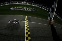Kyle Busch, driver of the #51 ToyotaCare Toyota, takes the checkered flag to win the NASCAR Camping World Truck Series SFP 250 at Kansas Speedway on May 9, 2014 in Kansas City, Kansas. Photo by Todd Warshaw/NASCAR via Getty Images