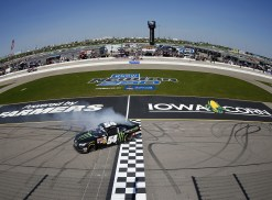 Sam Hornish Jr., driver of the #54 Monster Energy Toyota, does a burnout on the start/finish line after winning the NASCAR Nationwide Series Get To Know Newton 250 Presented By Sherwin Williams at Iowa Speedway on May 18, 2014 in Newton, Iowa. Photo by Matt Sullivan/Getty Images